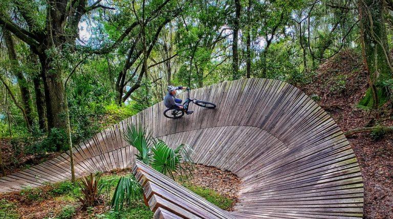 Mountain Biker on wooden berm