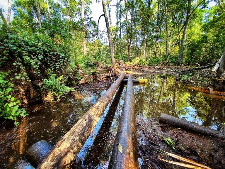 Building a bridge out of logs